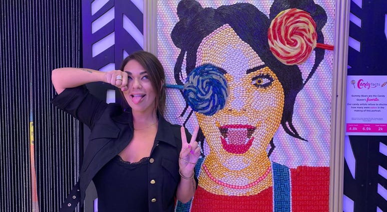 Co-founder Jackie Sorkin stands next to her own candy portrait.