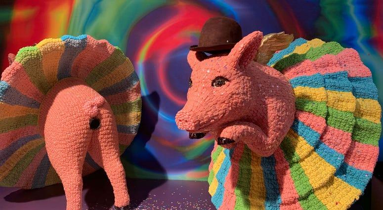 A candy sculpture of ballerina pigs.