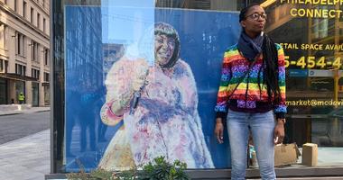 Visual artist Nile Livingston with her art.