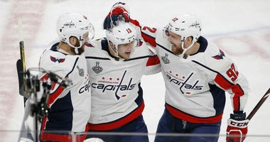 Washington Capitals left wing Jakub Vrana, center, celebrates his goal with right wing Tom Wilson, left, and center Evgeny Kuznetsov during the second period in Game 5 of the NHL hockey Stanley Cup Finals against the Vegas Golden Knights.