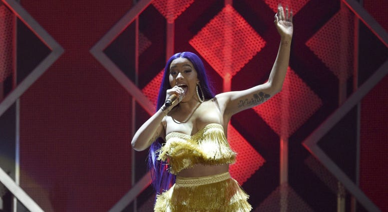 In this Nov. 30, 2018 file photo, Cardi B performs at Jingle Ball at The Forum in Inglewood, Calif.