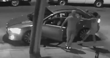 Two people are caught on video pistol whipping and car-jacking a Lyft driver in West Philly, and now police are trying to track them down.