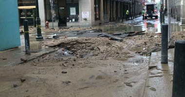 A muddy mess left behind at the site of a water mean break in Center City Philadelphia.
