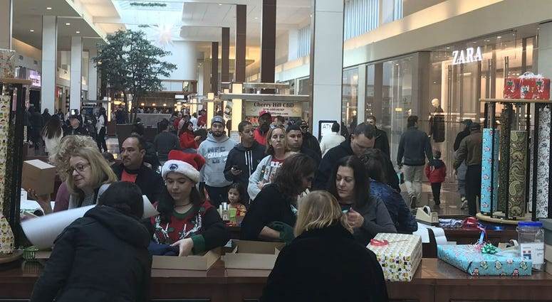 Wrappers at the Cherry Hill Mall are helping to play the role of Santa's little helpers, for last minute shoppers.