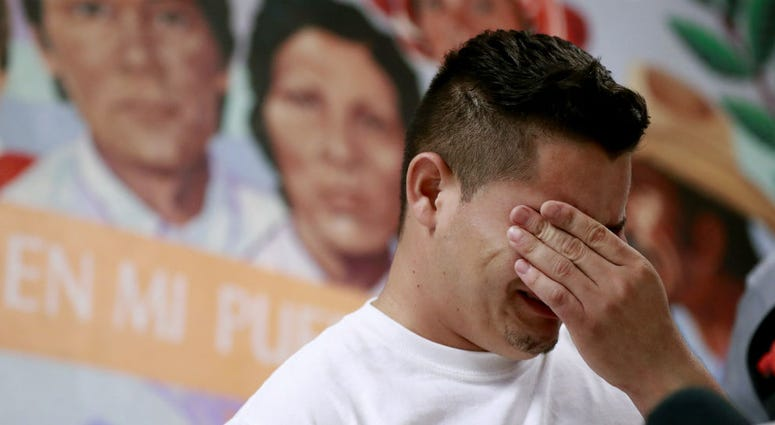 In this June 25, 2018 file photo, Christian, from Honduras, recounts his separation from his child at the border during a news conference at the Annunciation House,in El Paso, Texas.