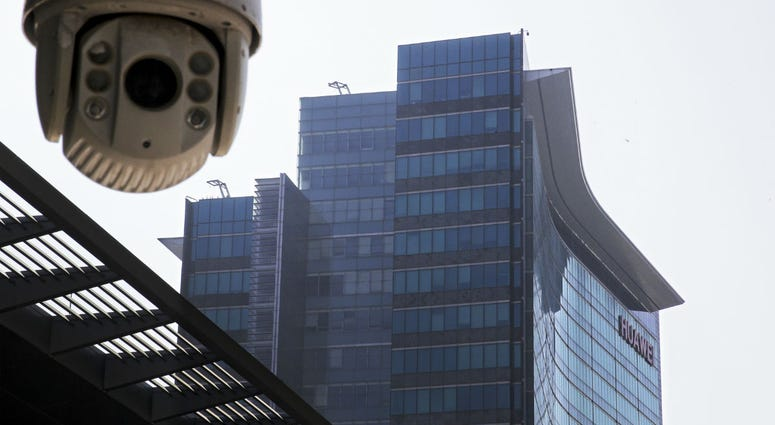 In this Dec. 18, 2018, photo, a surveillance camera is mounted near the Huawei headquarters in Shenzhen in south China's Guangdong province.