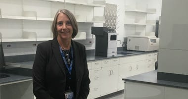 Dr. Beverly Davidson, chief scientific strategy officer at Children's Hospital of Philadelphia, stands in front of the Quality Control Lab in the new clinical manufacturing research complex off Civic Center Boulevard on the hospital campus.