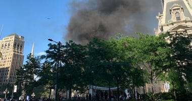 Smoke billowing after police cars were set on fire outside City Hall on May 30, 2020.