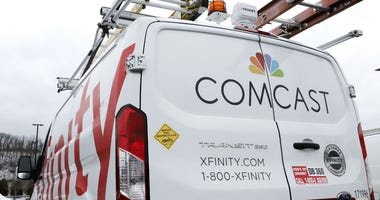 This Jan. 24, 2019, file photo shows a Comcast truck in Pittsburgh. Comcast Corp. reports earns on Thursday, April 25.