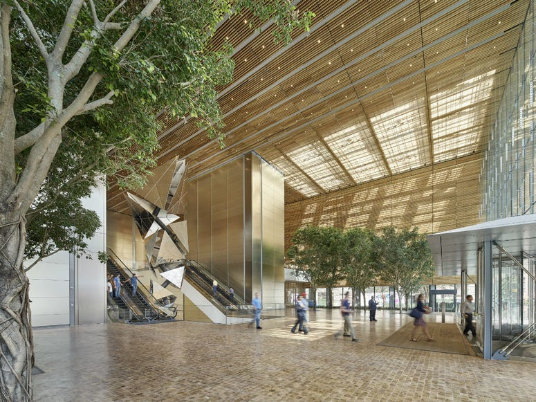 The building features a lobby that's open to the public, with end-cut white oak flooring and digital art on the ceiling.