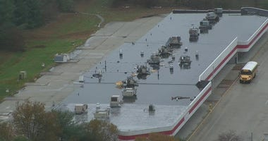 Thieves took copper coils from air conditioning units on this building's rooftop.