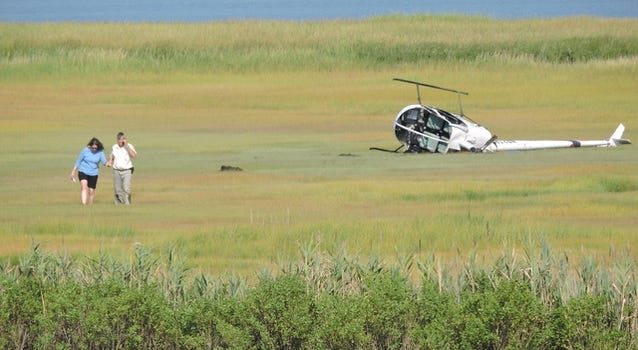 A crashed helicopter lies in the marsh grass near the Ocean City airport at 28th Street.