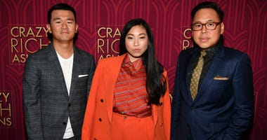 Ronny Chieng, Awkwafina, and Nico Santos attend the 'Crazy Rich Asians' Atlanta Red Carpet Screening at Regal Atlantic Station on August 2, 2018 in Atlanta, Georgia.
