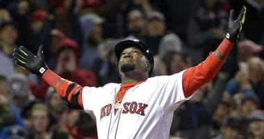 In this April 29, 2016, file photo, Boston Red Sox designated hitter David Ortiz celebrates his two-run home run against the New York Yankees during the eighth inning of a baseball game at Fenway Park, in Boston.