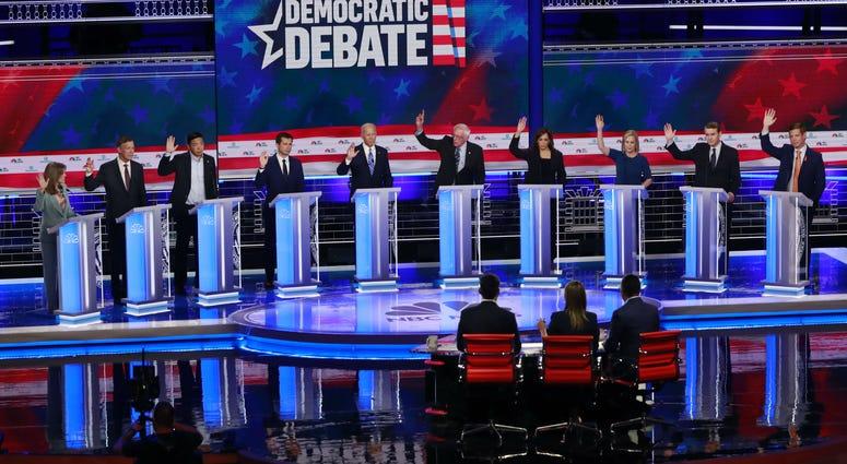 Democratic presidential candidates, Marianne Williamson, John Hickenlooper, Andrew Yang, Pete Buttigieg, Joe Biden, Bernie Sanders, Kamala Harris, Kirsten Gillibrand, Michael Bennet, Eric Swalwell, are shown during a Democratic primary debate.