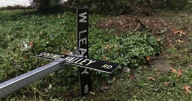 Authorities in Springfield, Delco say a  police chase ended when a car drove through this street sign, barreled over a tree on a front lawn and then slammed into a red pickup truck parked in a driveway.