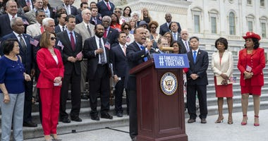 Rep. Luis Gutierrez, D-Ill., speaks as he is joined by House Democratic Leader Nancy Pelosi of California, second from left, and other House Democrats calling for passage of the Keep Families Together Act, at the Capitol in Washington.