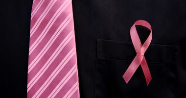 Symptoms of breast cancer in men.