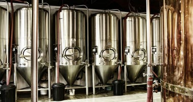 Interior views of small micro brewery processing and storage.