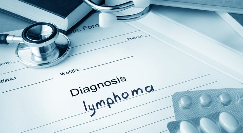 Diagnostic form with diagnosis lymphoma and pills.