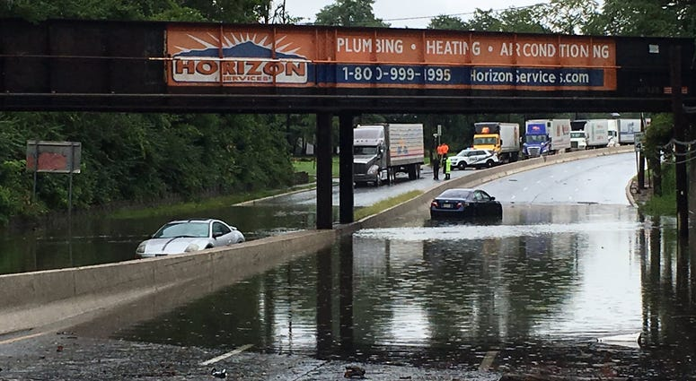 Two cars drowned in deep floodwaters on Rt 130 near Maple Ave in Pennsauken