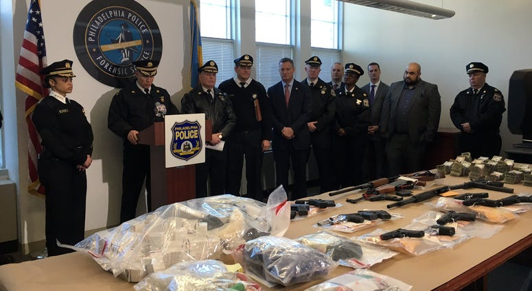 Philadelphia police show what they confiscated during a three-day anti-crime initiative.