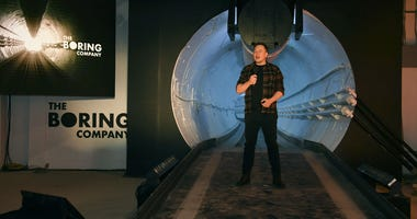 In this Dec. 18, 2018 file photo Elon Musk, co-founder and chief executive officer of Tesla Inc., speaks during an unveiling event for the Boring Co.