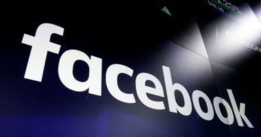 In this March 29, 2018, file photo the logo for social media giant Facebook, appears on screens at the Nasdaq MarketSite, in New York's Times Square.