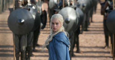 "This image released by HBO shows Emilia Clarke in a scene from ""Game of Thrones."" The final season premieres on Sunday."