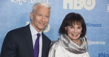 """In this April 4, 2016 file photo, CNN anchor Anderson Cooper and Gloria Vanderbilt attend the premiere of """"Nothing Left Unsaid"""" at the Time Warner Center in New York."""