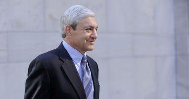 Former Penn State president Graham Spanier leaves his preliminary hearing in Harrisburg, Pennsylvania, Monday, July 29, 2013.