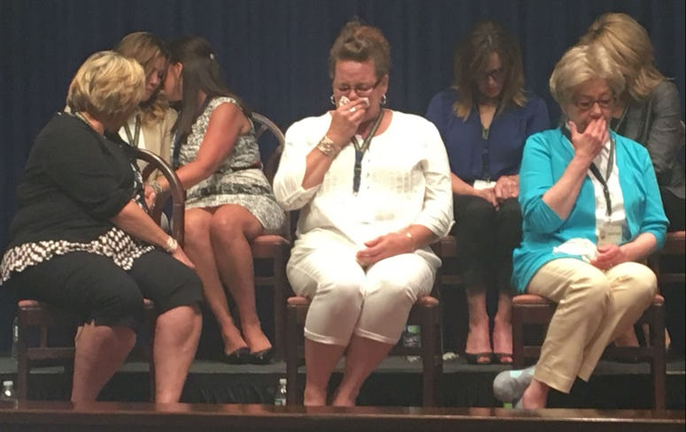 Victims weep as they listen to Attorney General Shapiro outline the grand jury report and a Capitol press conference.