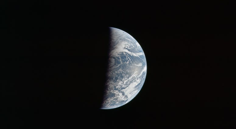 Earth at about 162,000 km or 87,500 nautical miles. North is down. The eastern Pacific Ocean dominates the view.