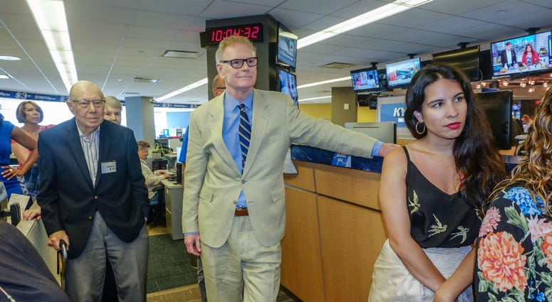 Retired KYW Newsradio reporter Tony Hanson joins former colleagues before receiving his Hall of Fame award.