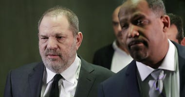 Harvey Weinstein, left, leaves court with attorney Ron Sullivan, Friday, Jan. 25, 2019, in New York.