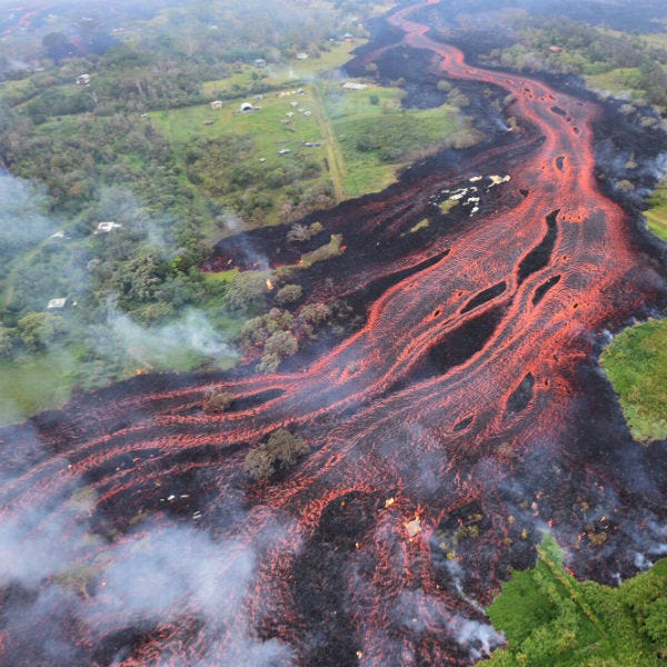 In this Saturday, May 19, 2018 file photo, released by the U.S. Geological Survey, lava flows from fissures near Pahoa, Hawaii.