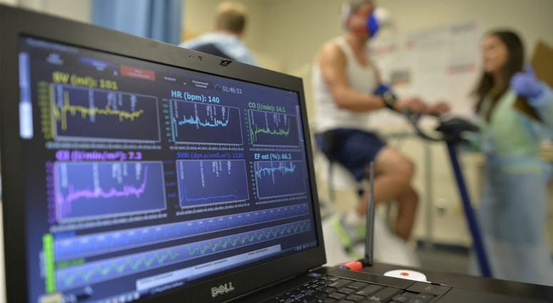 In this Aug. 27, 2014 file photo, a laptop computer monitors a patient's heart function as he takes a stress test while riding a stationary bike in Augusta, Ga.