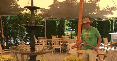 Pineville Tavern owner Andrew Abruzzese in the tent he bought for outdoor dining