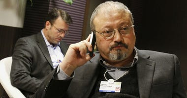 In this Jan. 29, 2011 file photo, Saudi journalist Jamal Khashoggi speaks on his cellphone at the World Economic Forum in Davos, Switzerland.