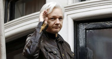 WikiLeaks founder Julian Assange greets supporters from a balcony of the Ecuadorian embassy in London.