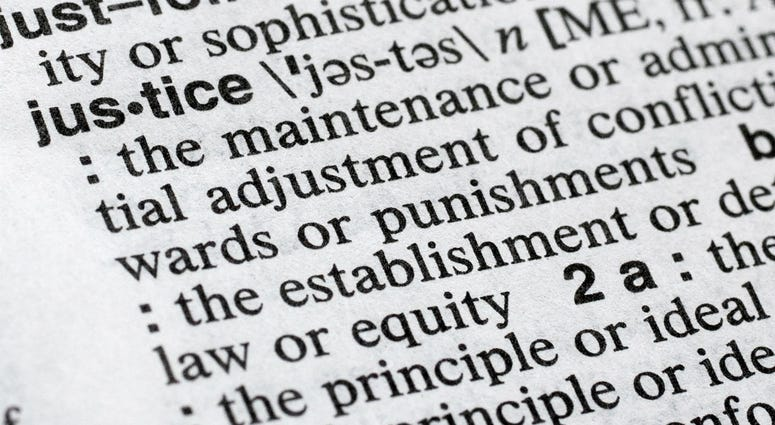 "In this Dec. 12, 2018, photo, ""justice"" is displayed in a Merriam-Webster dictionary in New York. Merriam-Webster has chosen ""justice"" as its 2018 word of the year, driven by the churning news cycle and President Trump's Twitter feed."