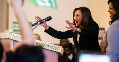 "Sen. Kamala Harris, D-CA, waves to supporters while being welcomed on stage by Deidre DeJear during a ""All Hands on Deck\"" event on Tuesday, Oct. 23, 2018, at Old Brick in Iowa City."