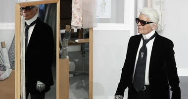 In this Tuesday, July 5, 2016 file photo, Karl Lagerfeld arrives at the end of Chanel's Haute Couture Fall-Winter 2016-2017 fashion collection presented in Paris.