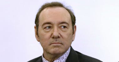 In this Jan. 7, 2019 file photo, actor Kevin Spacey stands in district court during arraignment on a charge of indecent assault and battery in Nantucket, Mass.