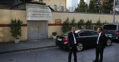 Security personnel guard Saudi Arabia's consulate in Istanbul, Monday, Oct. 22, 2018.