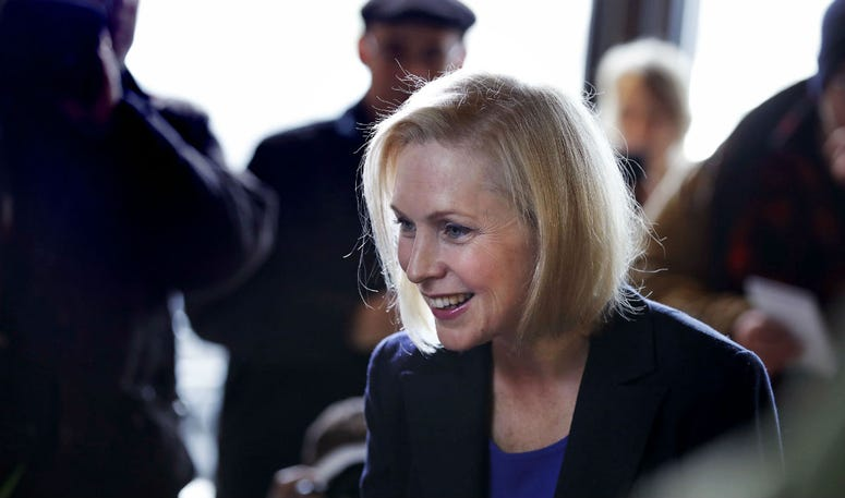 Sen. Kirsten Gillibrand, D-NY, smiles as she listens to a patron while visiting a coffee shop on Main Street in Concord, N.H., Friday, Feb. 15, 2019.