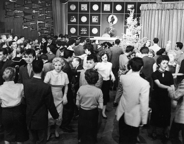 Teenagers dance on an episode of Dick Clark's television program, 'American Bandstand,' 1950s.