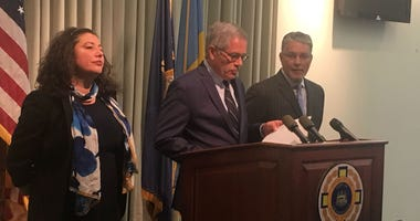 From left: Lyandra Retacco, supervisor of the charging unit; D.A. Larry Krasner; Anthony Voci, supervisor of the homicide unit