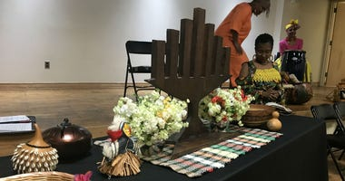 Symbols of Kwanzaa on a table at the African American Museum in Philadelphia