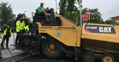 The Philadelphia Streets Department crew helped pave a block of Welsh Road in the Northeast Tuesday, with Eagles offensive tackle Lane Johnson at the wheel.